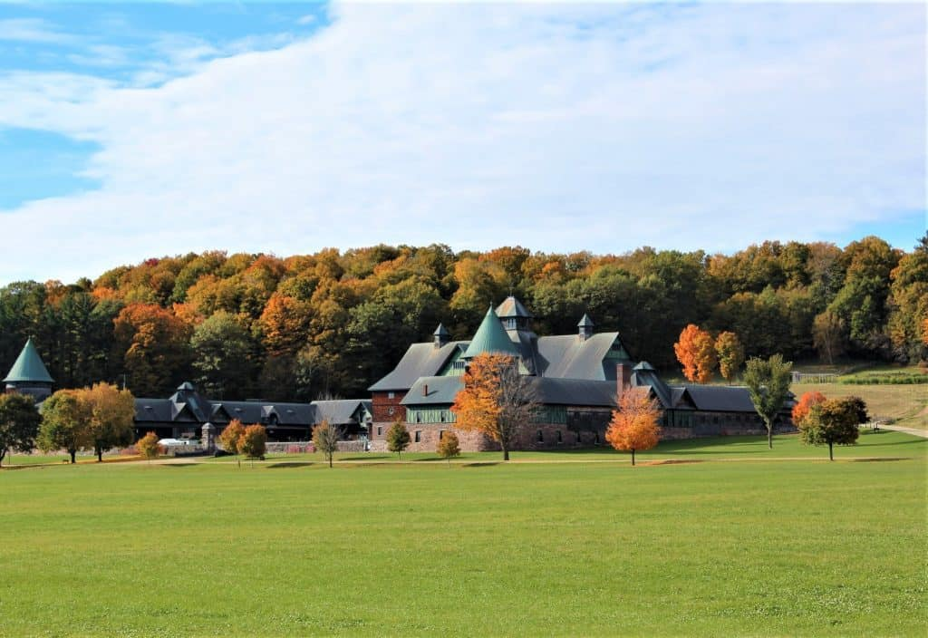 large modern looking farm with green grass - new england bucket list