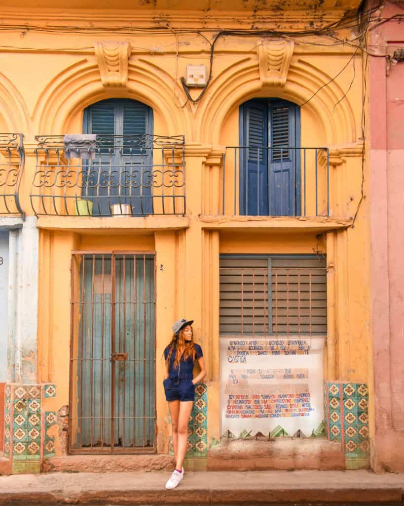 best places to stay in cuba - woman standing outside a building
